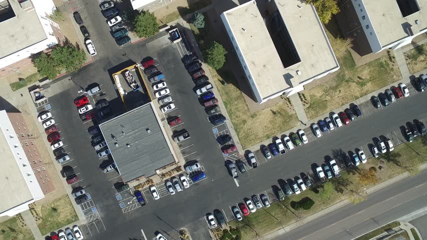 A birds eye view of a group of building roofs and parking lot   Shutterstock HD Video #21515761