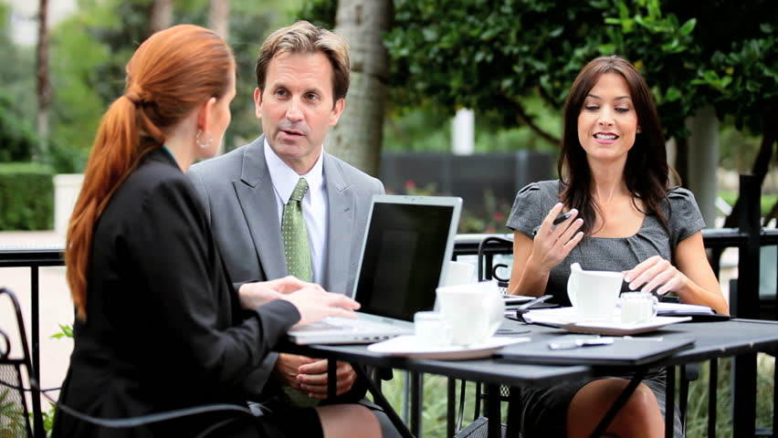 Team of business people at an outdoor cafe | Shutterstock HD Video #2153261