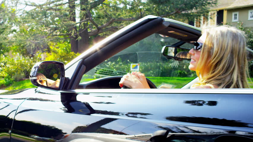 Young girls in a convertible cruising past luxury homes in California | Shutterstock HD Video #2153621