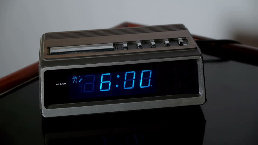 Alarm Clock Wake Up Snooze (HD). Digital alarm clock from the 70s rings and is hastily snoozed by a male hand angry for being woken up at 6am. | Shutterstock HD Video #2157608