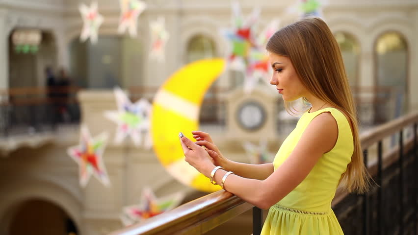 Young beautiful woman calls on his cell phone in the store | Shutterstock HD Video #21593701