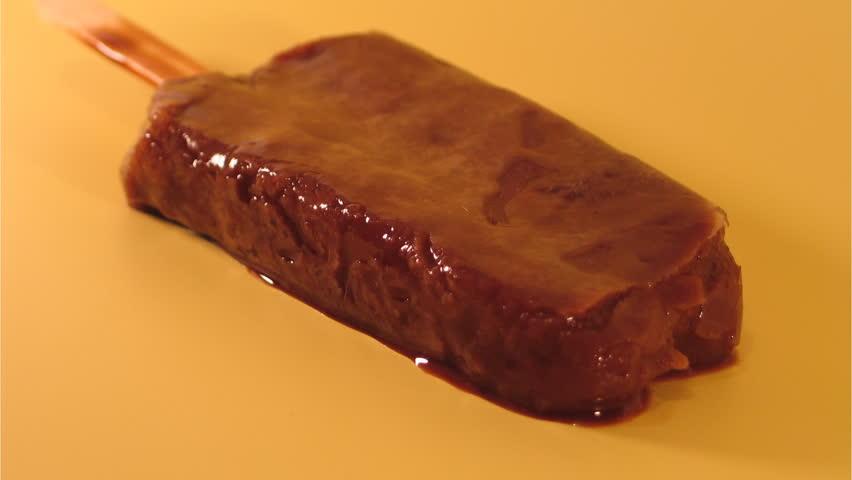 Melting chocolate popsicle