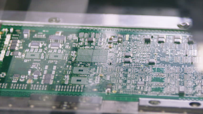 Surface Mount Technology (Smt) Machine places resistors, capacitors, transistors, LED and integrated circuits on circuit boards at high speed | Shutterstock HD Video #21678181