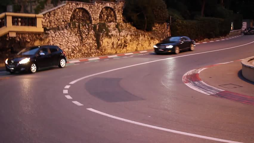 Monte-Carlo, Monaco - January 20, 2016: Luxury Black Bentley Continental  Driving Around the Fairmont Famous Hairpin Turn in Monte-Carlo, Monaco in The French Riviera