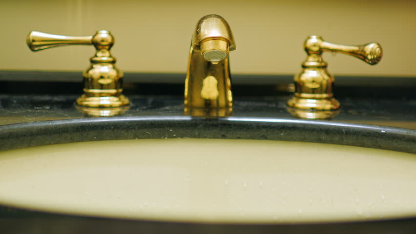Water Dripping From A Faucet In The Bathroom. Water Losses Stock ...