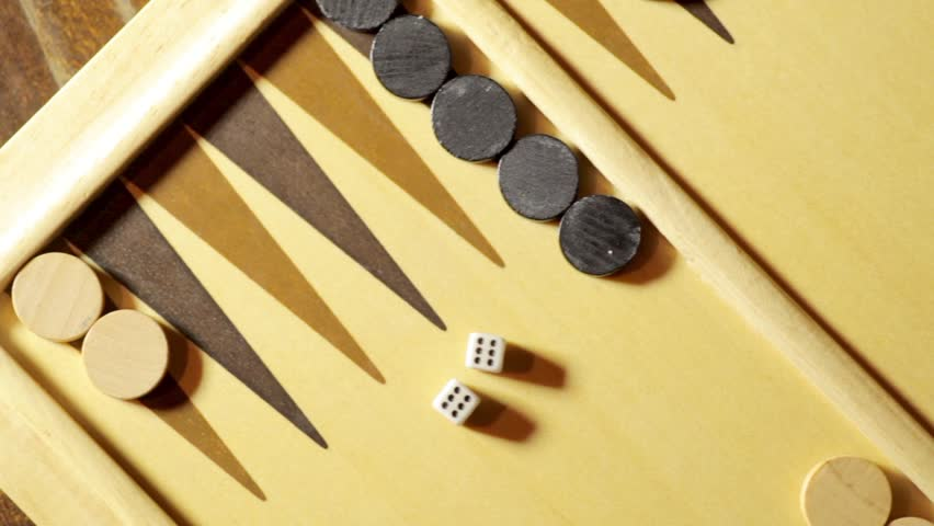 Panning shot of a backgammon board with dice, double six. | Shutterstock HD Video #21727015