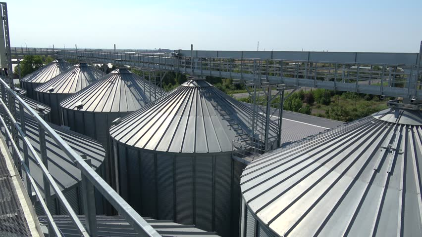 Roof View Silos Storage Agriculture Building Aerial View ,Handheld Camera  Balanced Steady Shot   4K