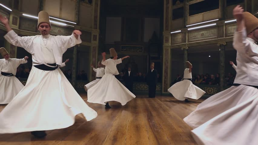 ISTANBUL, TURKEY - DECEMBER 17: Sufi whirling dervish (Semazen) dances on December 17, 2013 in Istanbul, Turkey.
