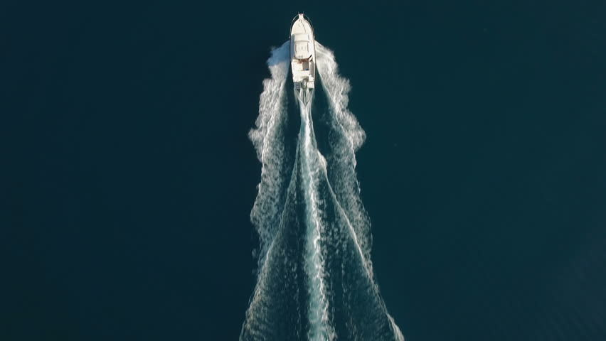Aerial - Top down view of catching luxury motor boat racing on the water #21833041