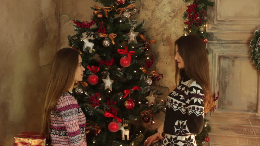 Two Girls Decorate Christmas Tree Stock Footage Video 100 Royalty