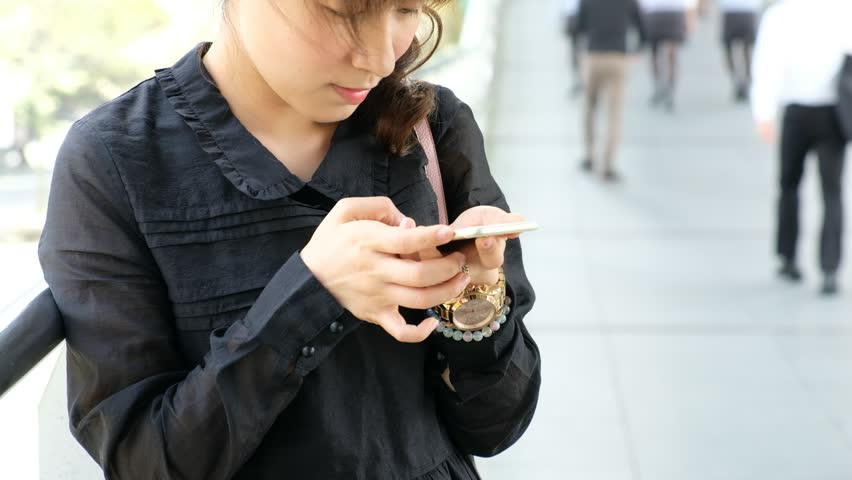 Woman use of smartphone at outdoor | Shutterstock HD Video #21839251