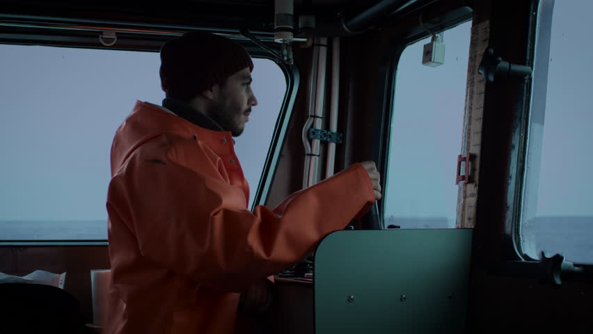 Captain Pilots Commercial Fishing Ship. Shot on RED Cinema Camera in 4K (UHD).