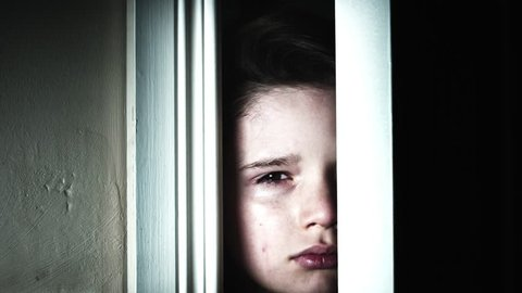 4K Thriller Child Eye Looking through Door Gap and Crying