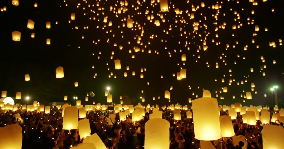 Lanterns floating in night sky at Yi Peng Festival. Chiangmai, Thailand. 4k