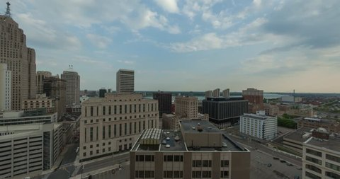Timelapse of the Detroit, Michigan skyline from day to night as the city lights are illuminated during sunset and twilight.