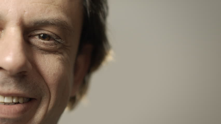 Portrait of happy caucasian adult man smiling at camera. Cropped view, grey background, copy space #2192302