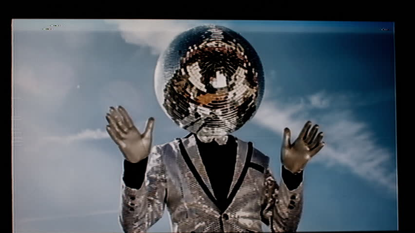 Mr discoball. a super cool disco club character enjoying some summer sunshine.  this version has been distorted with video glitches and effects | Shutterstock HD Video #21935146