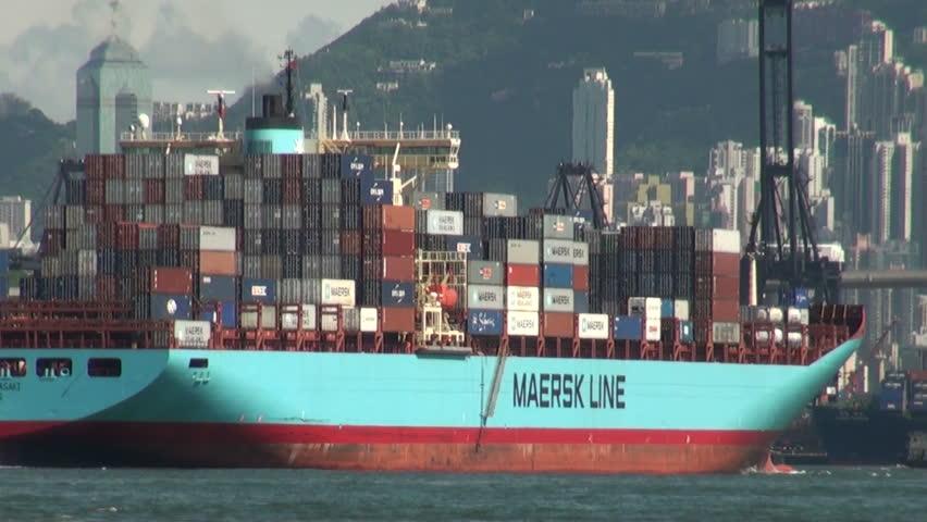 HONG KONG - 27 JULY: A cargo ship leaves the harbor on July 27, 2010 in   Hong Kong, China.