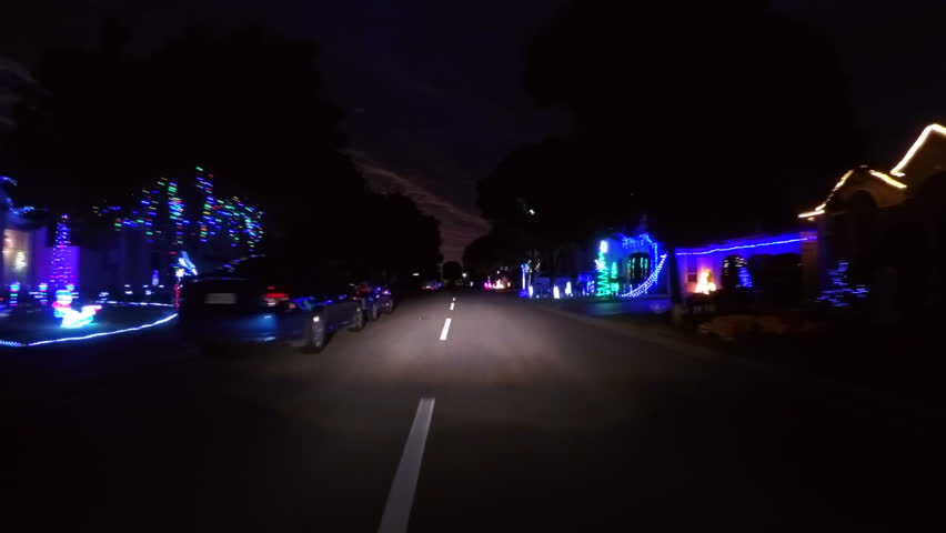 Adelaide, South Australia, Christmas street lights with rows of homes decorated for the festive holiday season, vehicle POV.