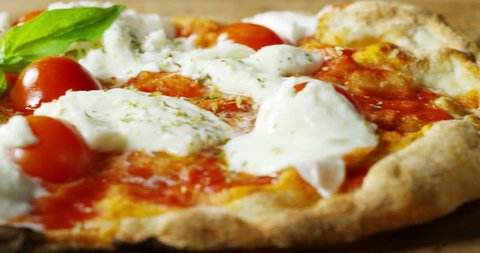 high quality pizza typical Italian food with Italian mozzarella cheese and fresh tomato sauce freshly harvested, with a fragrant basil leaf.Concept of: italian food, italy, restaurants and tradition.
