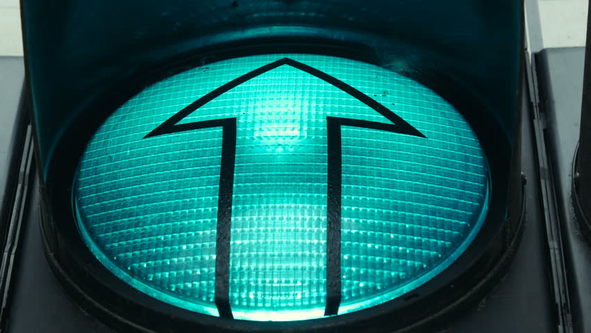 Close up shot of a green traffic light implying you are ready to go straight.