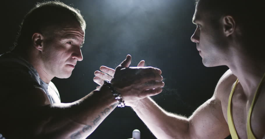 Two strong mans armwrestling in atheletic common-room