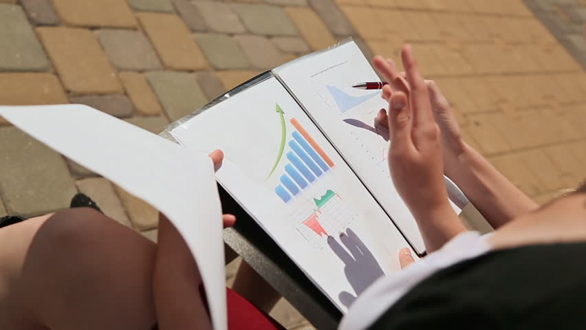 LIDA, BELARUS - JULY 20, 2016: Closeup of female hands working with documents, charts outdoors. | Shutterstock HD Video #22043320