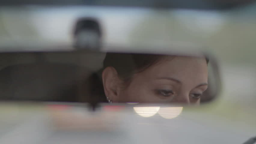 Young Girl Reflection In Car Rear View Mirror   Shutterstock HD Video #22053211