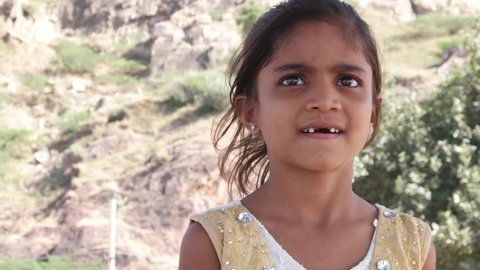 Finger pointing straight towards the camera by a lovely little Indian girl with missing teeth