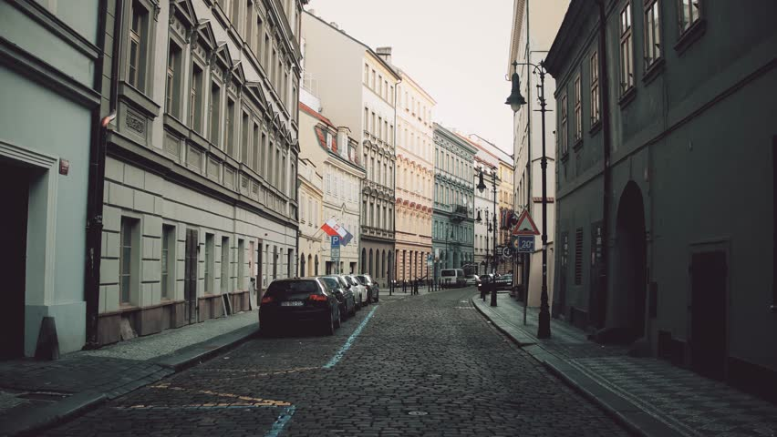 PRAGUE, CZECH REPUBLIC - DECEMBER 3, 2016. 4K steadicam video of a narrow cobblestone paved street with parked cars. Old european city view | Shutterstock HD Video #22100608