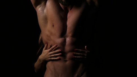 A Woman with her hands on a Sexy Muscular Chest of a Man