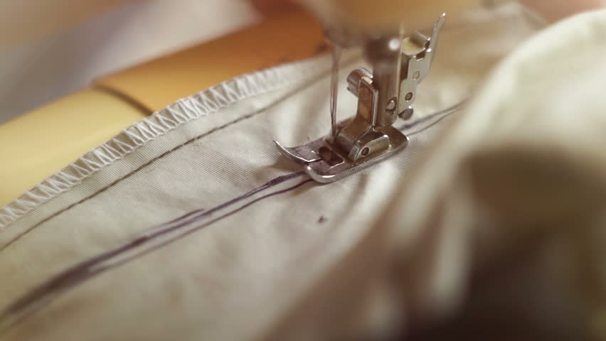 Close-up The tailor sewing on the sewing machine | Shutterstock HD Video #22118281