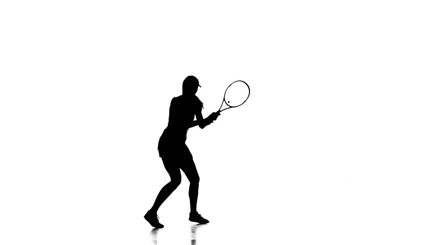 Girl tennis player playing tennis and jumping. White background. silhouette