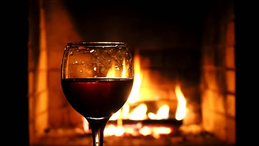 Red Wine Glass In Front Of A Warm Cozy Fireplace In The Background ...