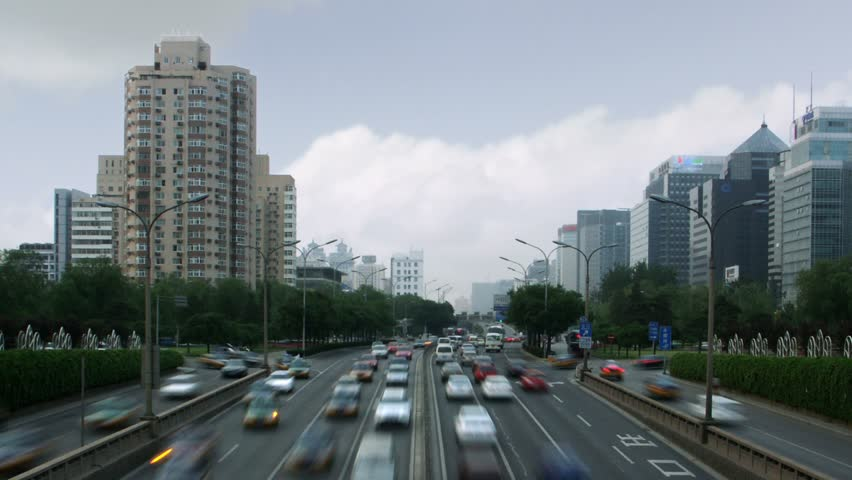 Timelapse of traffic and apartment buildings in Beijing, China.