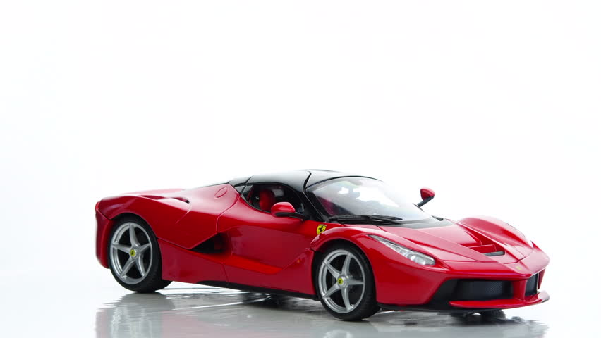 4k00:25KAMPEN, THE NETHERLANDS   DECEMBER 12, 2016: Ferrari La Ferrari  Supercar By BBurago Model Car Rotating Against A White Background.