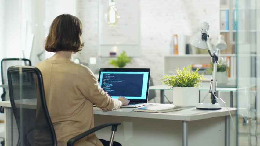Young Creative Woman Developer Writes Code on Her Desktop Computer. She Sits in Her Modern developer Office. Shot on RED Cinema Camera in 4K (UHD). | Shutterstock HD Video #22195291