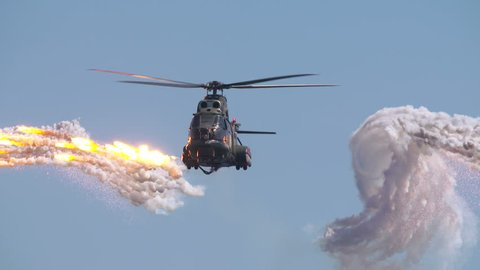 Helicopter launched anti missile flares in a slow motion scene. Stealth evasive maneuvers