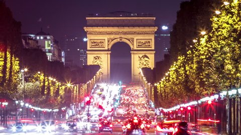 Time Lapse of the busy traffic on Avenue des Champs-\xCC\xE4lys?es. The Arc de Triomphe is in the background.
