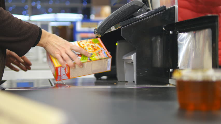 Shopper paying for products at checkout. Foods on conveyor belt at the supermarket. Cash desk with cashier and terminal in hypermarket. Working of cashier. Shopping at store. Close up | Shutterstock HD Video #22208155