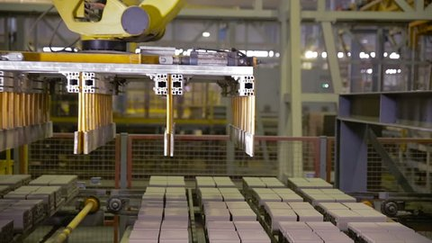 Modern factory equipment. Robots working at industrial factory.