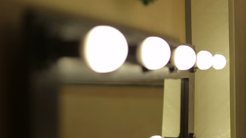 Beautiful mirror with lamps in the beauty salon. Make-up mirror. Dressing room mirror. Barber mirror.