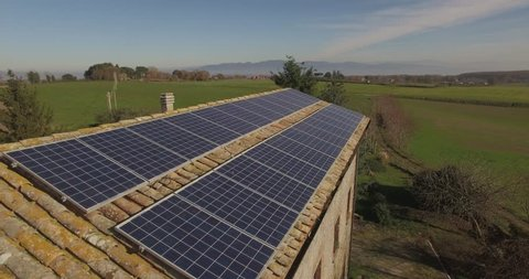 Solar panels on an ancient country house Italy. Country landscape .