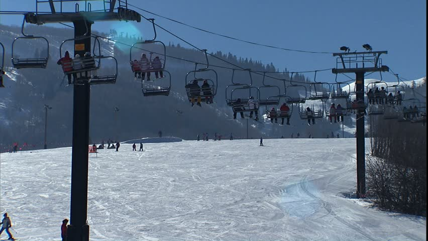 Ski lifts and slopes with skiers at Park City resort