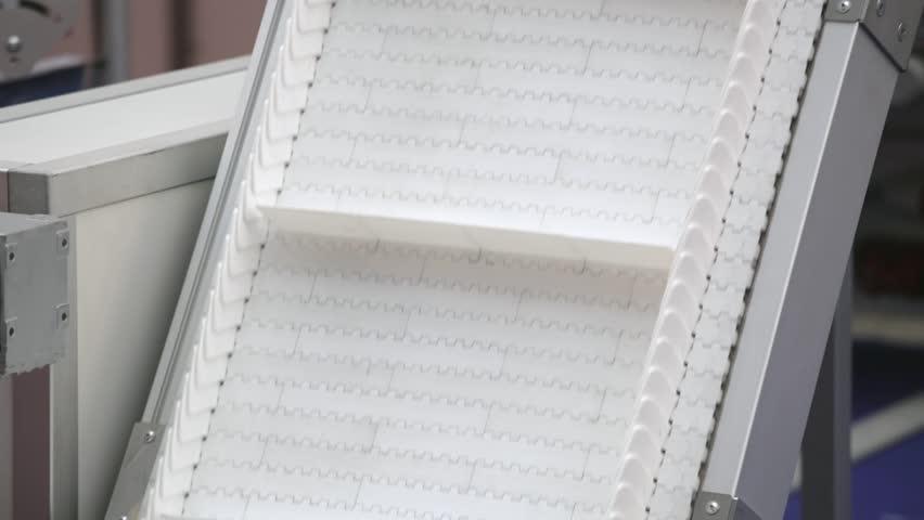 Plastic Conveyor Belt Transport System at Factory Line | Shutterstock HD Video #22278031