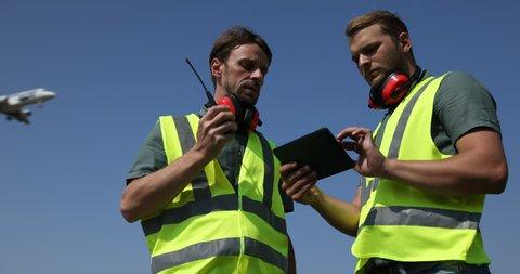 Airport Employee Talk Two Way Walkie Talkie Holding Transceiver Radio Team Work. Ultra High Definition, UltraHD, Ultra HD, UHD, 4K, 2160P, 4096x2160