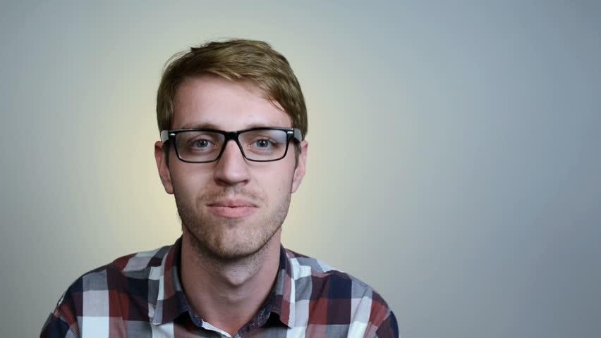 752832e507e Closeup portrait of young man in glasses