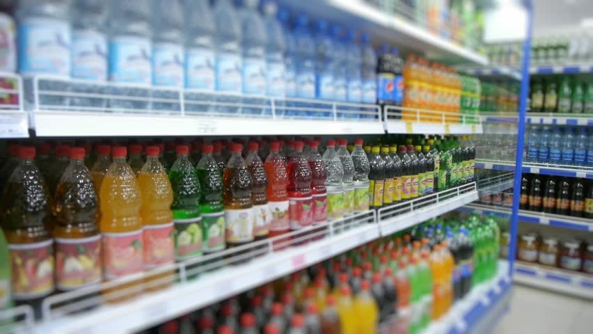 Fizzy drinks on the supermarket shelf, blurry | Shutterstock HD Video #22317271