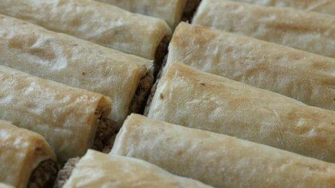 Phyllo pie baklawa with walnuts slow pan 4K 2160p 30fps UHD footage - Sweet baklava  dessert filo dough rolls filled with nuts 3840X2160 UltraHD panning video