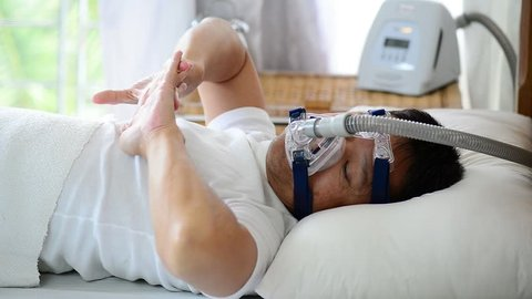 Healthy senior man wearing cpap mask waking up freshly with  smiling face from smooth sleeping all night long,healthcare concept.Obstructive sleep apnea therapy.